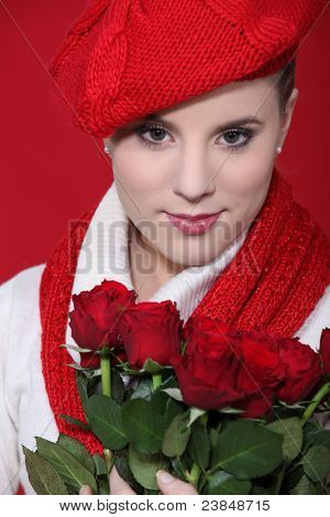 Stylish woman holding a bouquet of red roses