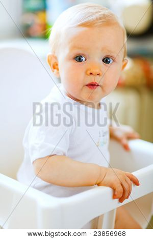 Eat Smeared Pretty Baby In Baby Chair Interestedly Looking