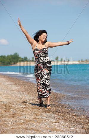 Healthy Looking Plus Size Model Walking on Beach