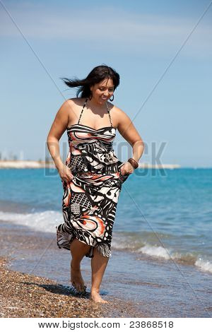 Healthy Looking Plus Size Model Walking on Beach