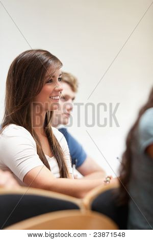 Portrait of a smiling student sitting in an amphitheater