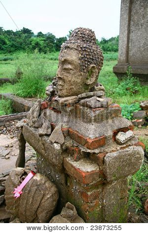 Buddha Statue Head on old brick