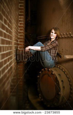 Beautiful Young Woman Sitting By Boiler