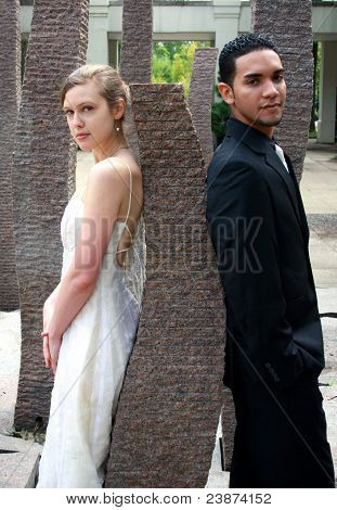 Bride And Groom Against A Rock