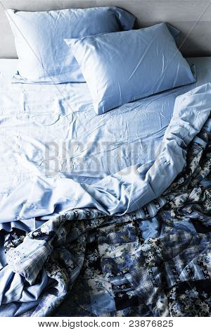 Unmade Bed And Bedding