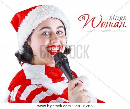 Girl In Christmas Dress Singing Into A Microphone