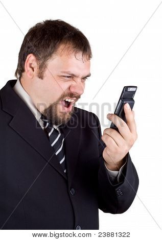 Businessman Shouting Into A Mobile Phone