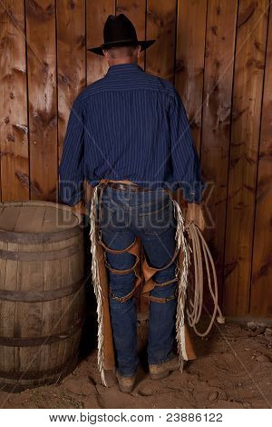 Back Of Cowboy By Barrel