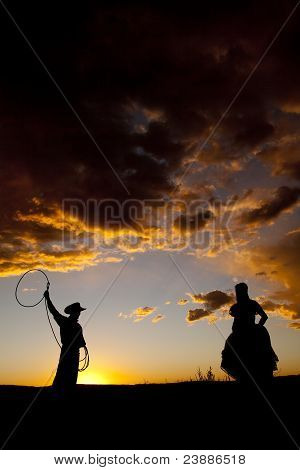 Cowboy Couple Silhouette Rope Swing