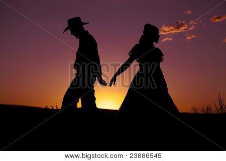 Cowboy Couple Silhouette Walk Away