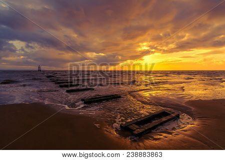 Golden Sunset On Incoming Tide