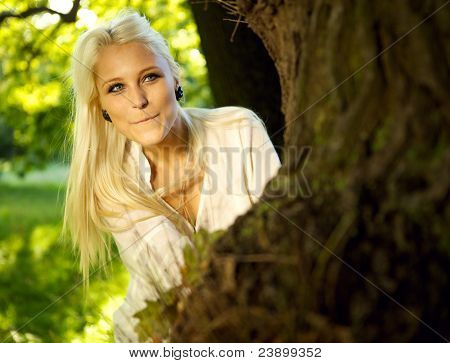 Pretty Woman Hiding Behind Tree
