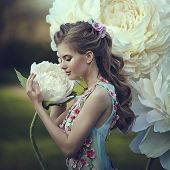 Portrait Of The Beautiful Girl As Thumbelina In A Blue Dress Near The Giant Peony Flowers. Blonde Wi poster