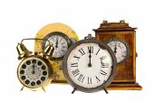 All vintage clocks at twelve hours isolated over white