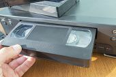 Videocassette Is Put Into The Video Recorder To Watch The Video, Another Video Cassette Is On The Vi poster