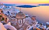Evening view of Thira town and Aegean sea at sundown, Santorini Island, Greece                      poster