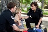 stock photo of triage  - Emergency medical professionals assessing an injured patient - JPG