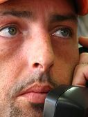 stock photo of people talking phone  - closeup of the face of a young mature man talking on the phone - JPG