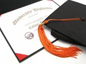 College Diploma With Cap And Tassel