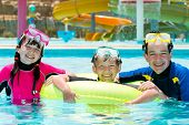 pic of swimming pool family  - Children snorkeling in pool - JPG