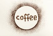 Circle Drawn With Ground Coffee And Text Coffee Written With Roasted Beans On White Isolated Backgro poster