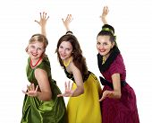 pic of poodle skirt  - three stylish young woman in bright colour dresses - JPG