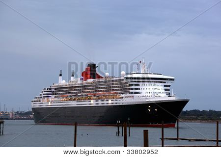 SOUTHAMPTON, UK - 5 JUNE: Cunard ships Queen Mary 2 & Queen Victoria meet in the port of Southampton to join the Queen Elizabeth to celebrate the Diamond Jubilee. 5 JUNE 2012
