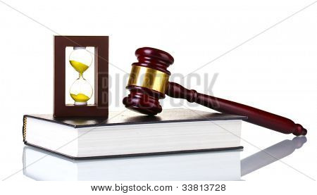 wooden gavel, book and hourglass isolated on white