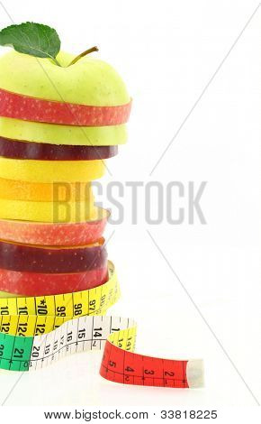 Diet concept. Fruits with measuring tape