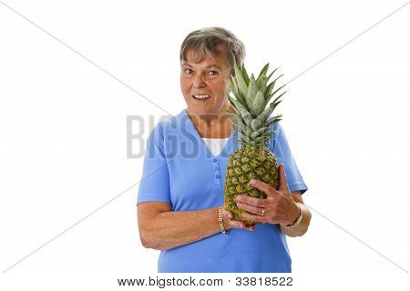 Female Senior Holding Fresh Pineapple