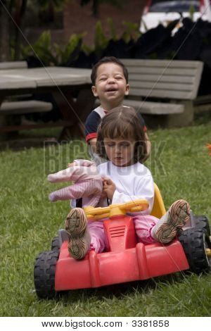 Girl And Boy Playing