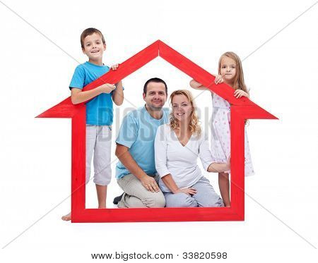 Young family with two kids holding house sign - new home concept, isolated