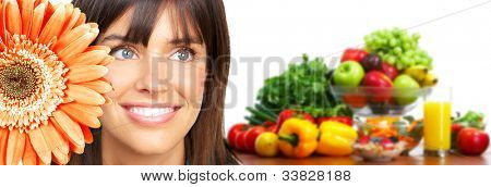 Young smiling woman with fruits and vegetables. Over white background. Healthy lifestyle.