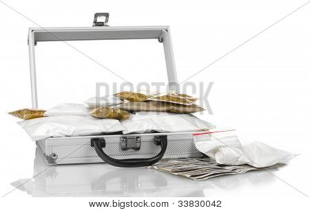 Cocaine and marijuana in a suitcase isolated on white