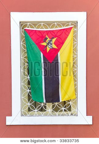 Flag of Mozambique on window in Maputo
