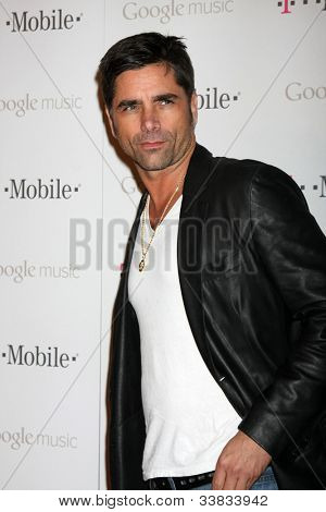 LOS ANGELES - NOV 16:  John Stamos arrives at the Google Music Launch at Mr. Brainwash Studio on November 16, 2011 in Los Angeles, CA