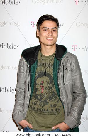 LOS ANGELES - NOV 16:  Kiowa Gordon arrives at the Google Music Launch at Mr. Brainwash Studio on November 16, 2011 in Los Angeles, CA