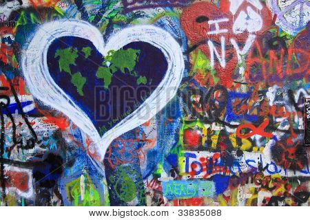 PRAGUE, CZECH REPUBLIC - MAY 26: The Lennon Wall is covered with John Lennon-inspired graffiti and lyrics from Beatles songs on May 26, 2012 in Prague, Czech Republic