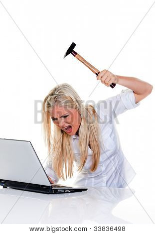 woman with computer problems, laptop and hammer: