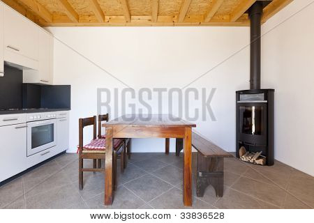 room with table and wood stove, rural home interior