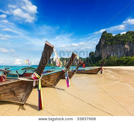 Long tail boats on tropical beach (Railay beach) in Thailand