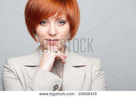 Red-haired woman in business clothing