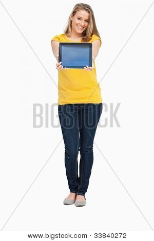 Blonde woman smiling while showing a touch pad screen against white background