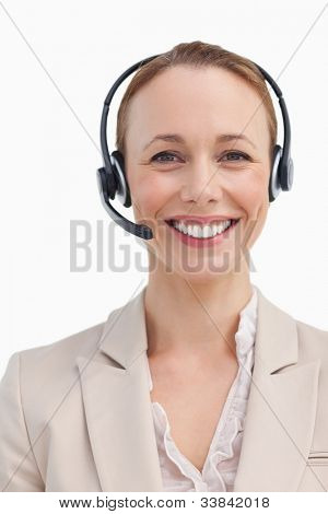 Portrait of a smiling businesswoman wearing a headset against white background