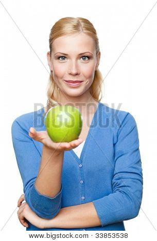Smiling attractive woman offers a green apple, isolated