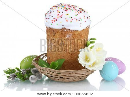 Beautiful Easter cake in basket, colorful eggs and flowers isolated on white