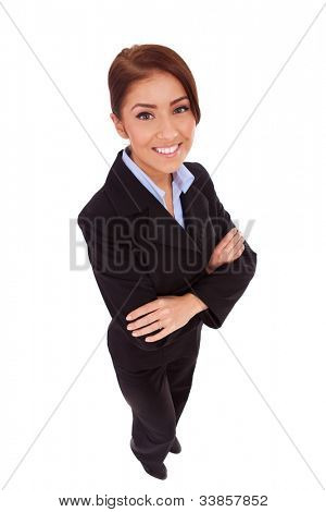 happy business woman with her arms crossed (isolated on white) - wide angle shot