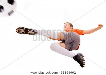 Boy kicking soccer ball, isolated on white