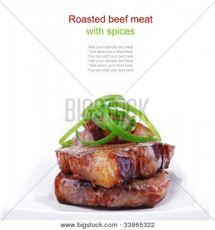 roasted beef meat strips on white ceramic plate isolated over white background