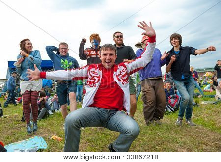 "ETNOMIR, RUSSIA - JUNE 2: Unidentified people having fun on open-air international ethnic music ""Wild Mint"" Festival on June 2, 2012 in Etnomir near Borovsk city, Russia"